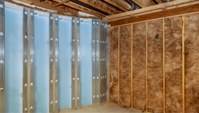 A basement with insulation that will improve energy efficiency.