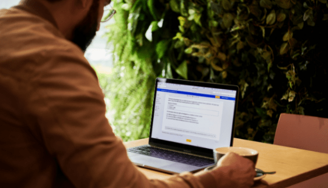 A condo owner reading FHA approval on a computer.