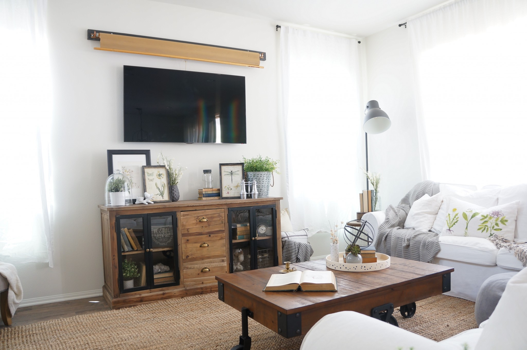 hiding tv in living room furniture layout rules solutionhome love stories i started searching everywhere on the internet to find an easy stylish solution for our giant black box finally came across one photo of a map and