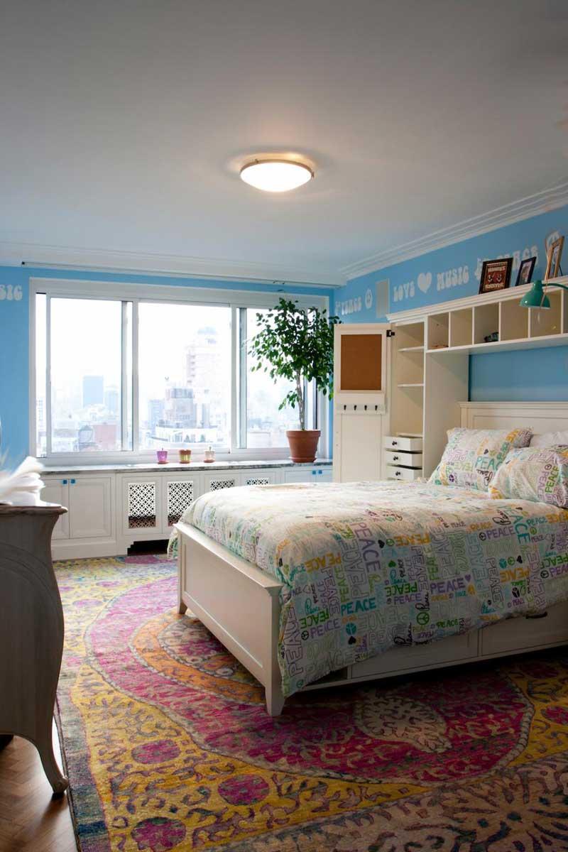 Teenage Girl Bedroom With Pink and Yellow Rug
