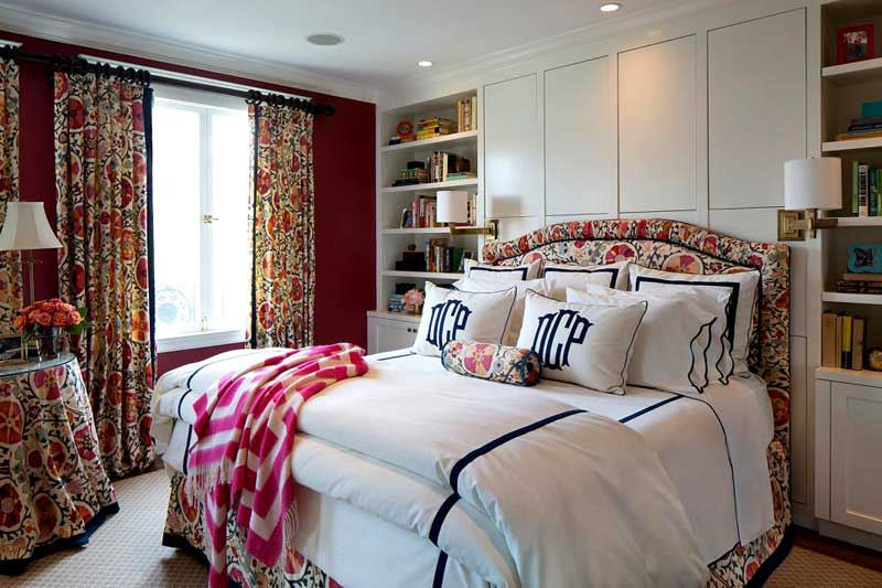 Bold Red Bedroom With Floral Curtains