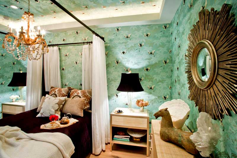Green Bedroom With Printed Wallpaper