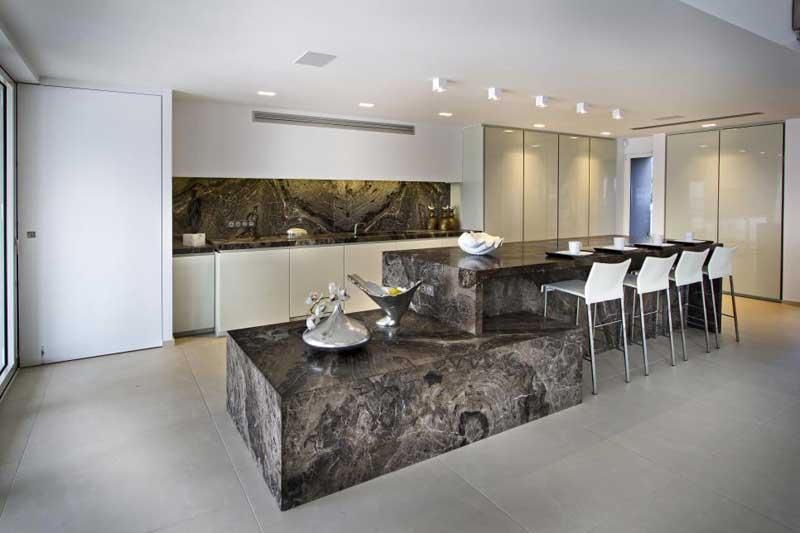 Multi Level Brown Stone Kitchen Island