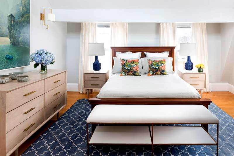 Pale Blue Bedroom With Blue Geometric Rug