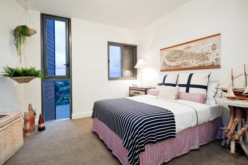White Bedroom With Striped Bedding