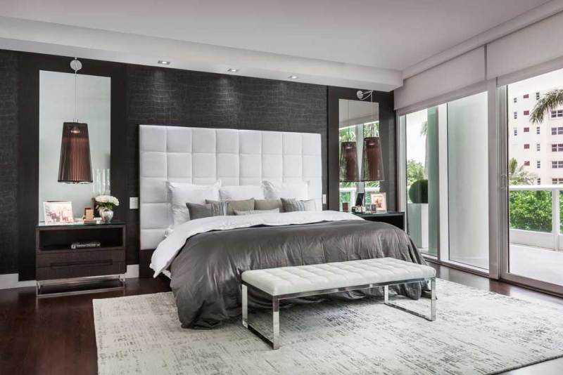 modern bedroom with pendant lighting