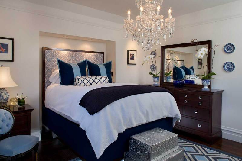 small bedroom with candle chandelier