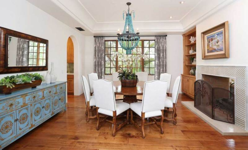 dining room with blue beaded chandelier light