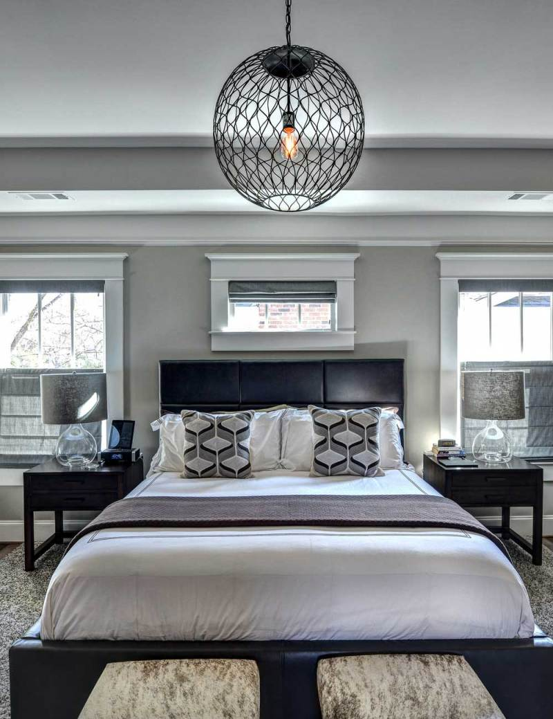 small bedroom with orb pendant lights