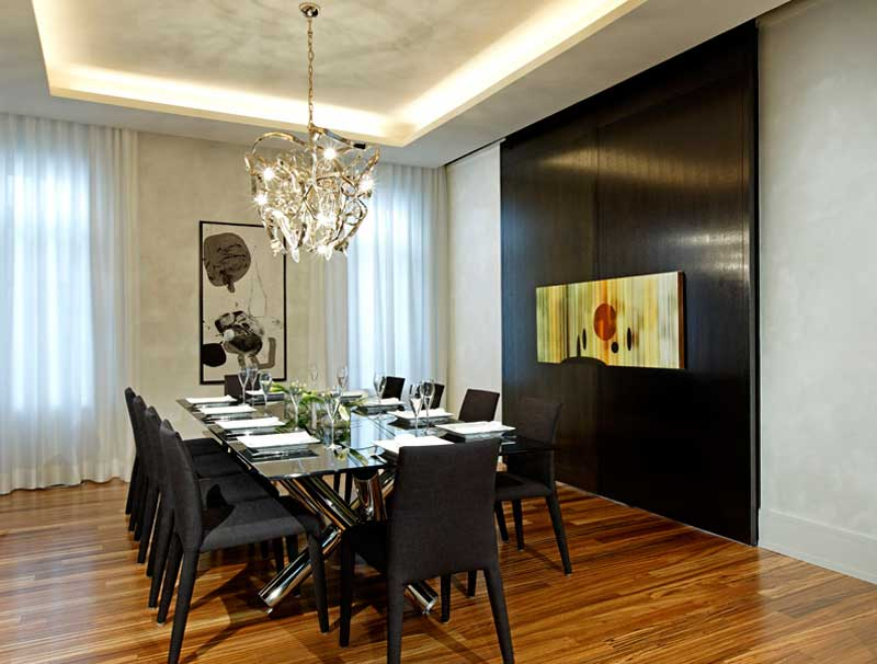 modern formal dining room with crystal chandelier