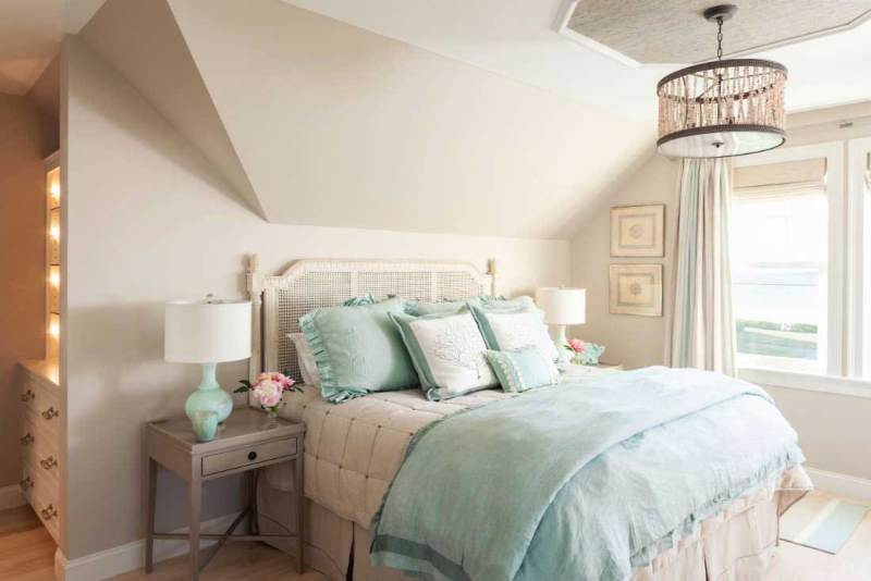 small bedroom with drum shade pendant light