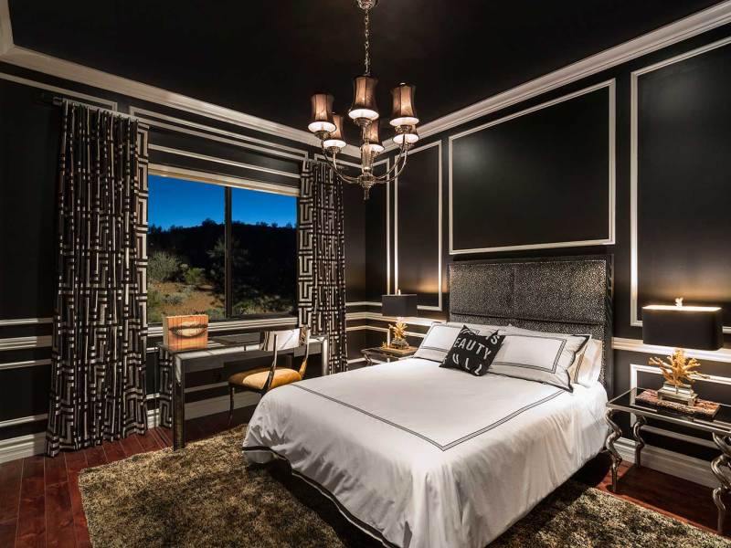 black bedroom with chandelier lighting