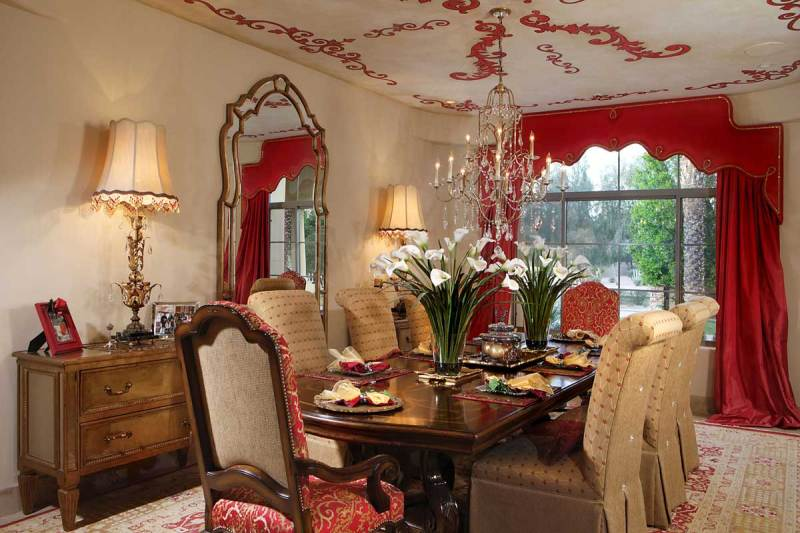formal dining room with table lamps and crystal candle chandelier