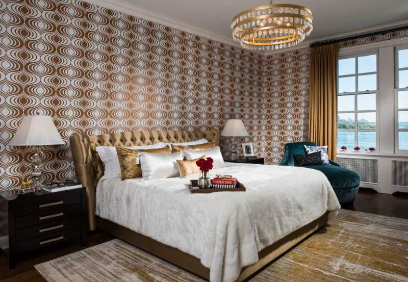 master bedroom with gold chandelier