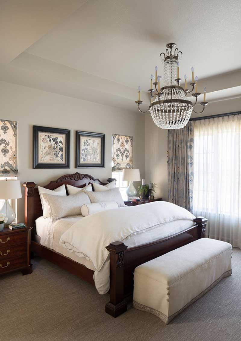 bedroom with beaded candle chandelier