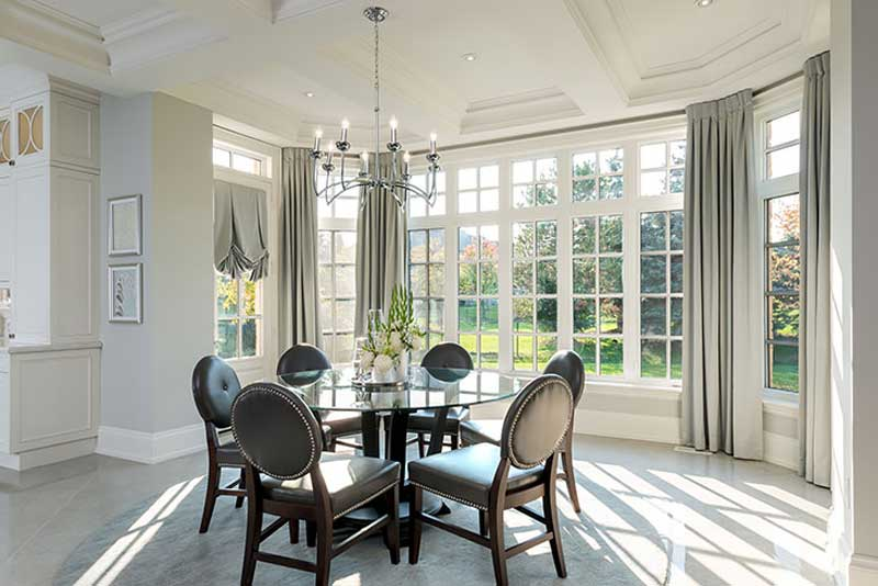dining room with natural lighting and chandeliers