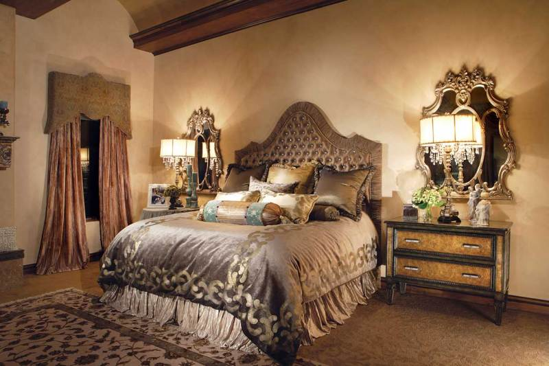 rustic bedroom with crystal chandelier table lamps
