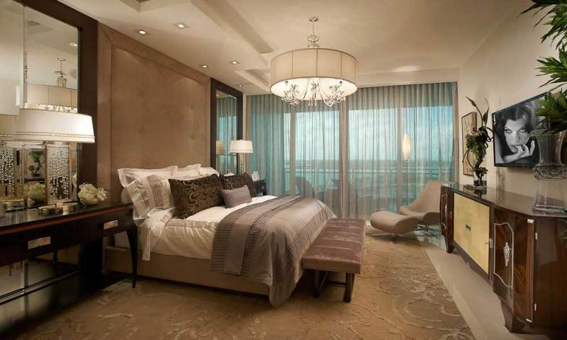 master bedroom with drum shade chandeliers