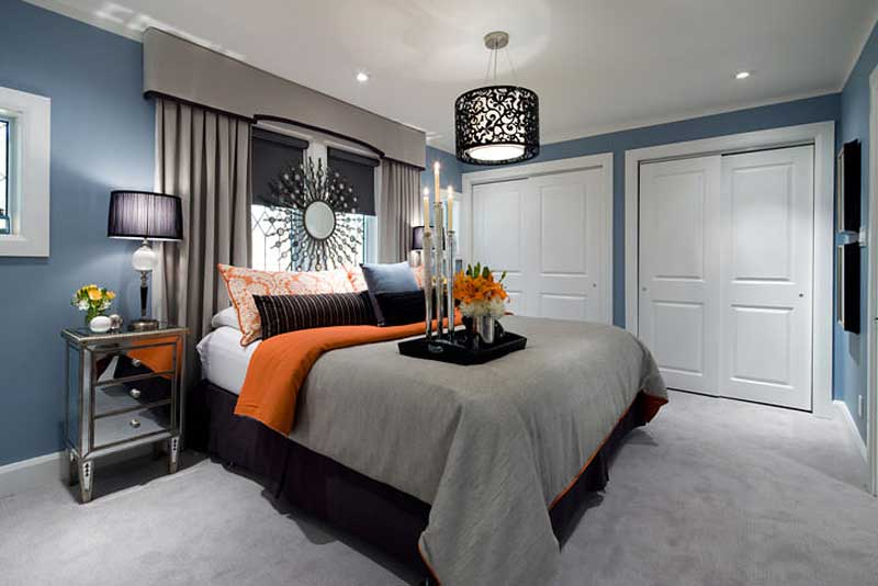 master bedroom with black table lamps and black drum chandelier