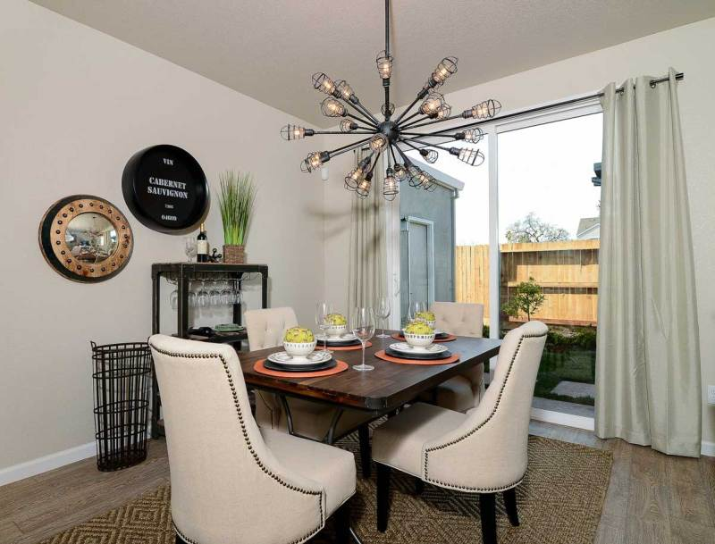 small dining room with sputnik style chandeliers
