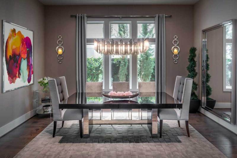 gray dining room with linear crystal chandelier