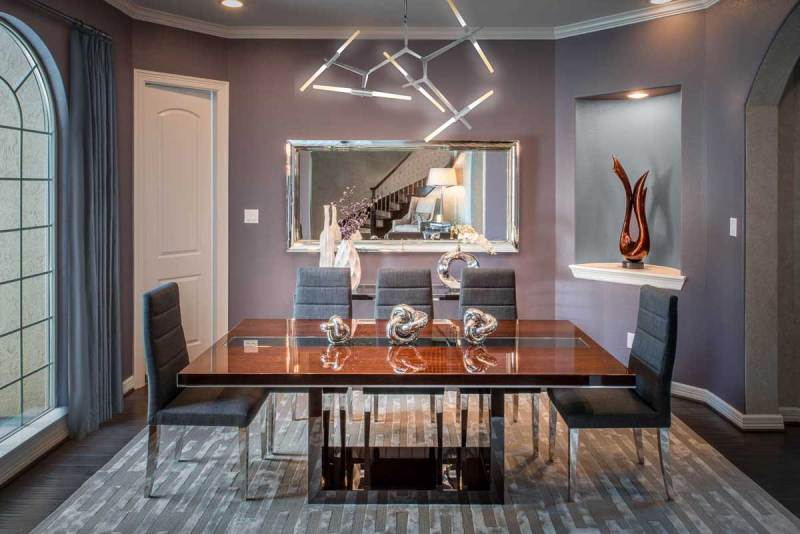 dining room with branch pendant light