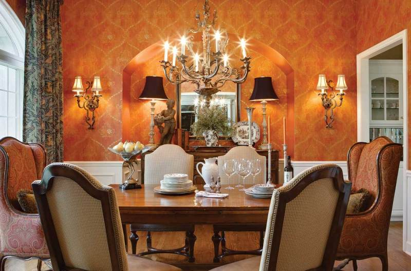 traditional dining room with table lamps, wall sconces and chandelier