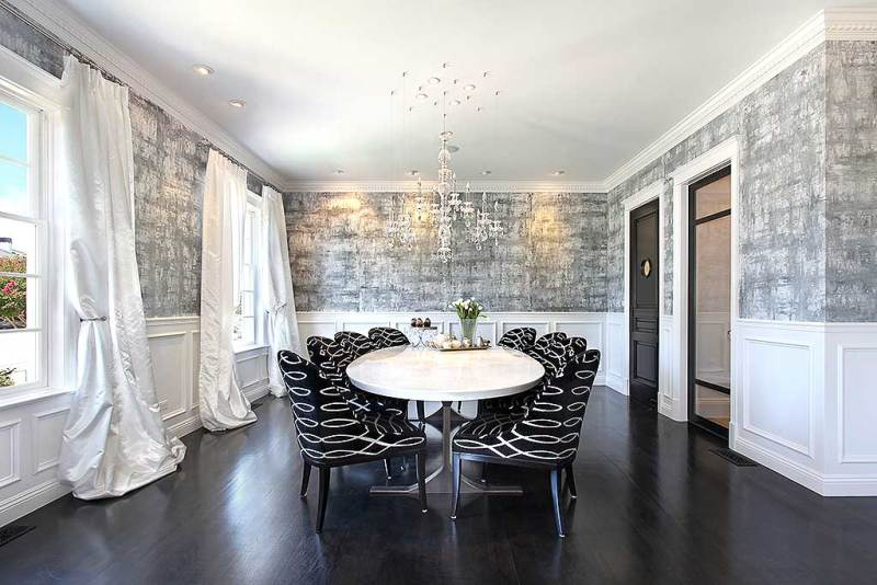 black and white dining room with glass candle chandelier
