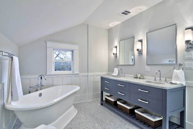 small bathroom with modern wall sconces