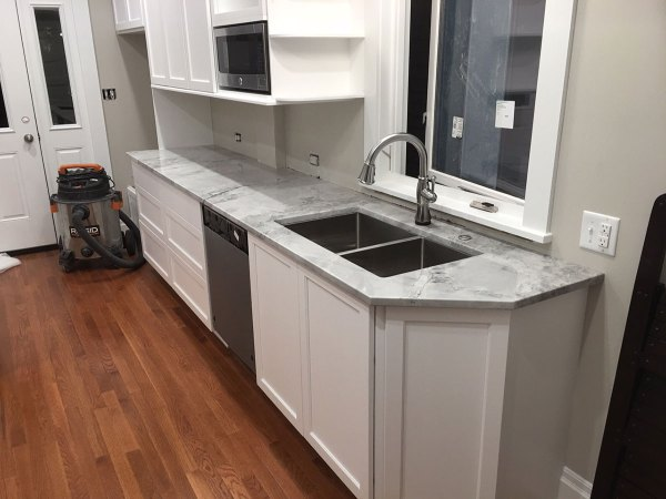 White Kitchen with Granite Countertops