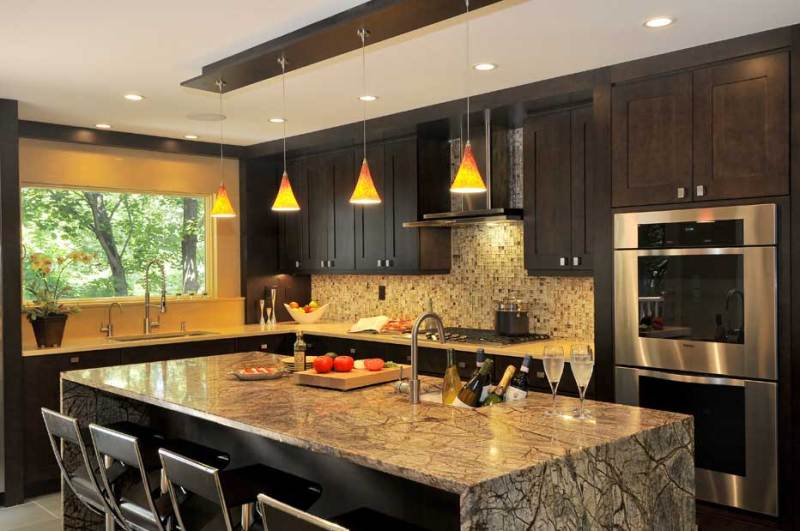 kitchen with orange glass pendant light