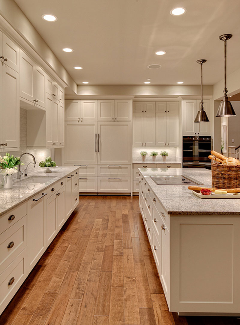 Traditional white kitchen with kashmir white granite countertops