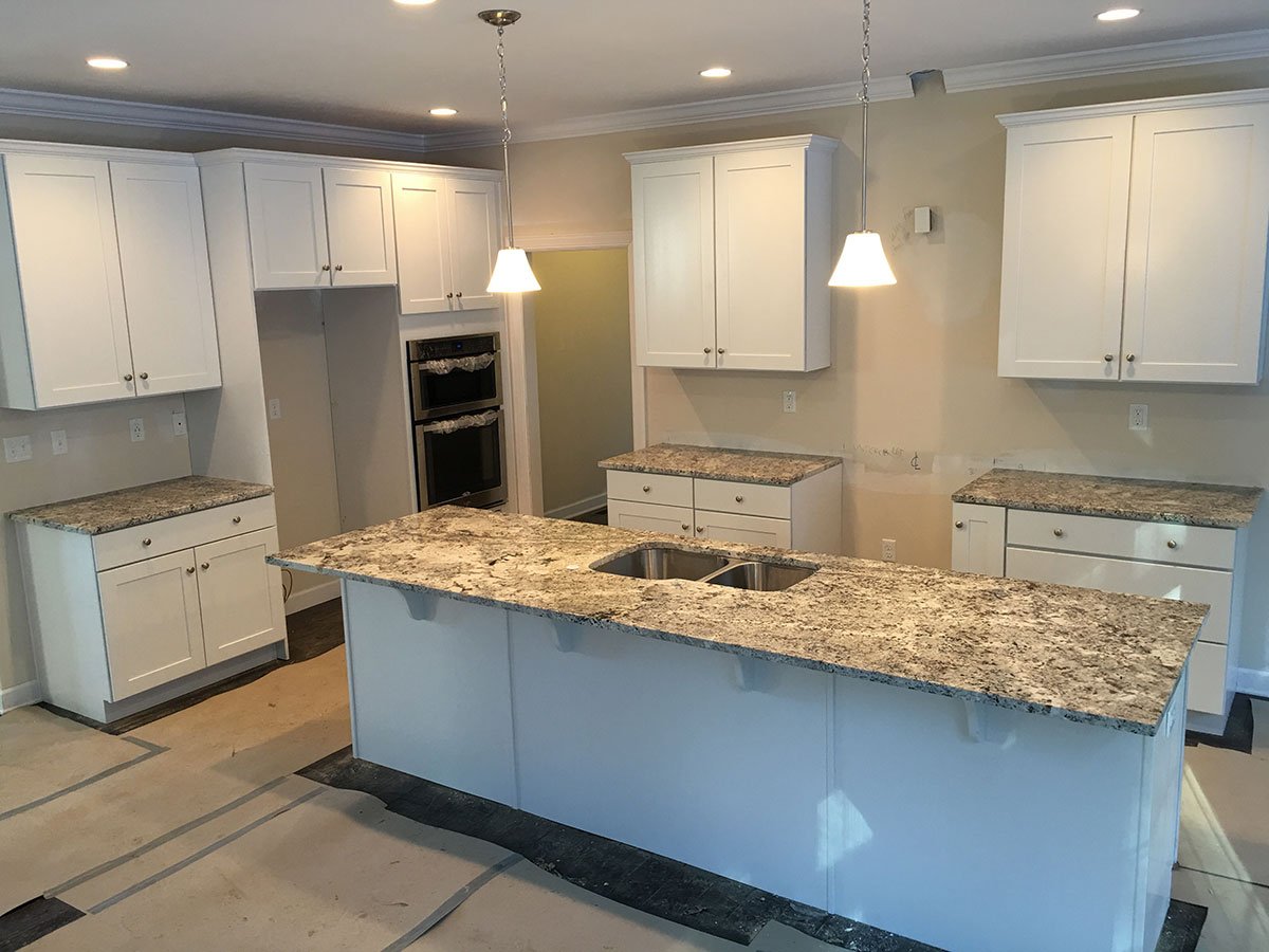 White Kitchen With Alaska White Granite Countertops