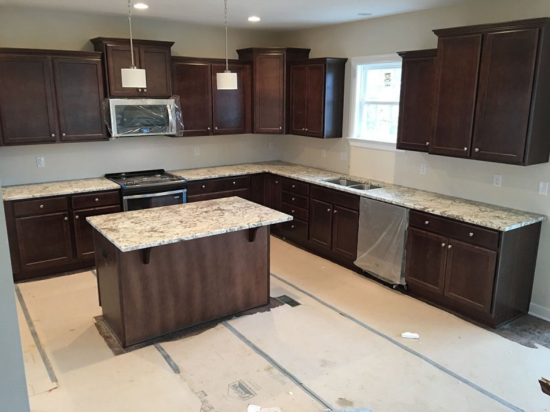 Dark cabinets with white spring granite countertops