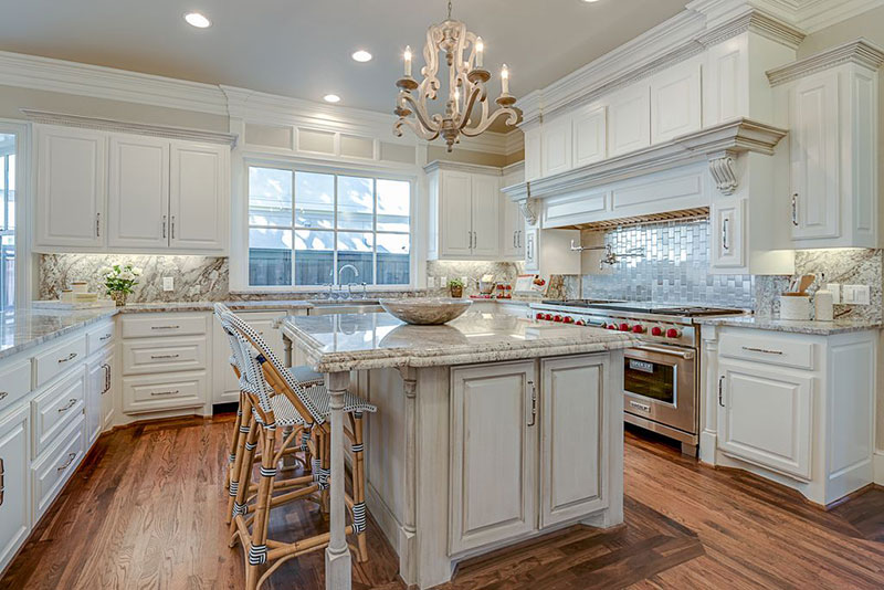 Traditional kitchen with aspen white granite countertops