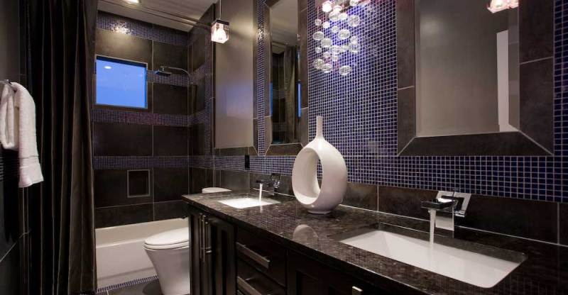 45 bathroom lighting ideas to complement the room homeluf small bathroom with wall sconce chandelier aloadofball Gallery