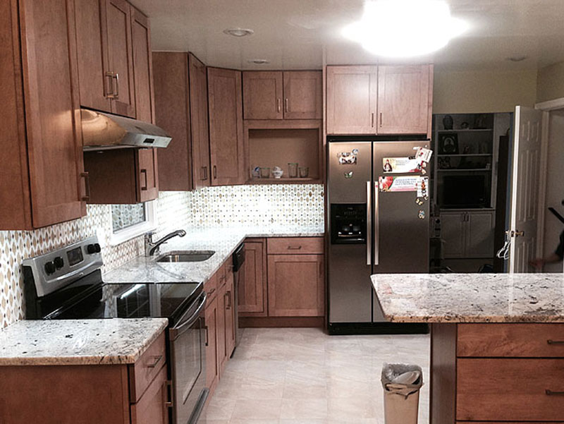 Maple kitchen cabinets with glacier white granite countertops