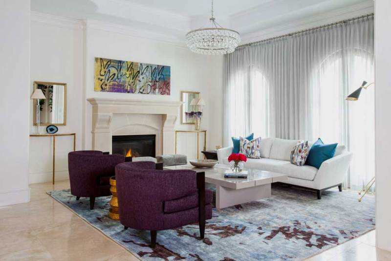 living room with modern crystal pendant lamp