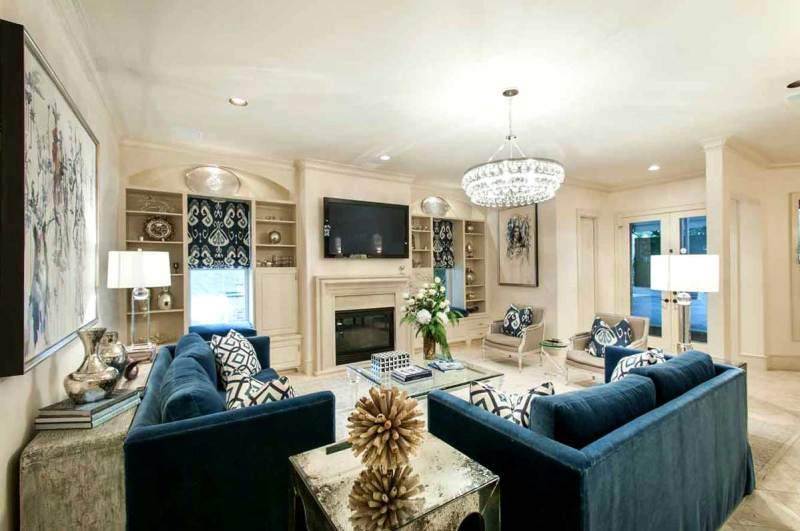living room with square table lamps and round crystal chandeliers
