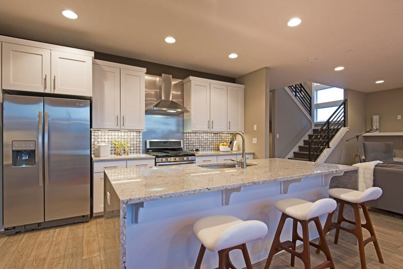 White kitchen with andromeda white granite countertops