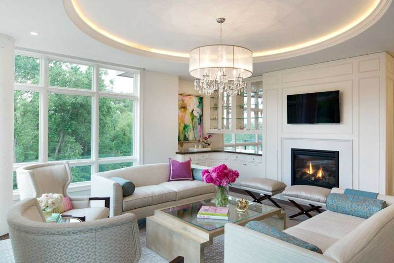living room with drum shade chandeliers and led lighting