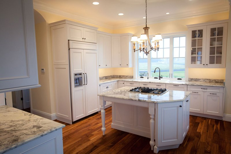 Traditional kitchen with supreme white granite countertops
