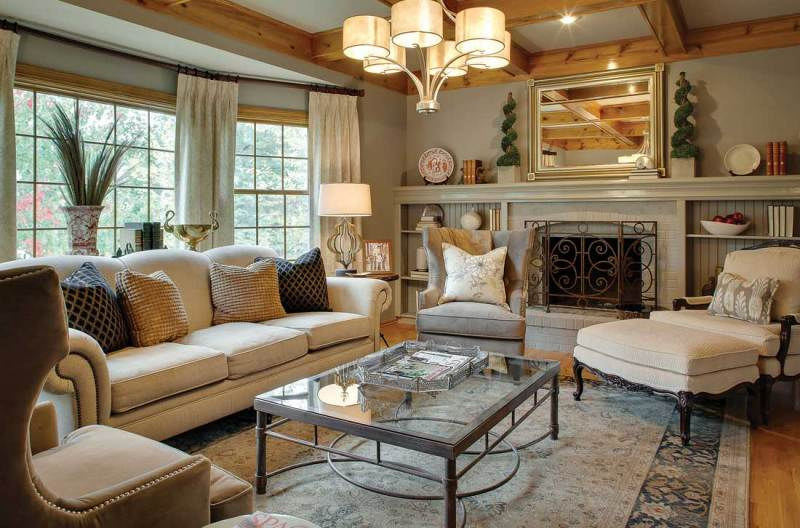 living room with 6 light drum shade brass chandelier