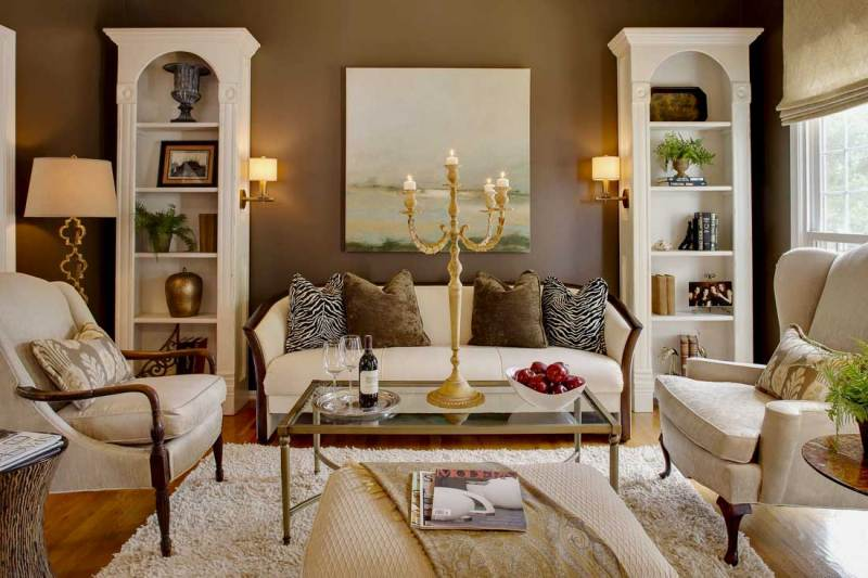 living room with candle table lamp and wall sconces