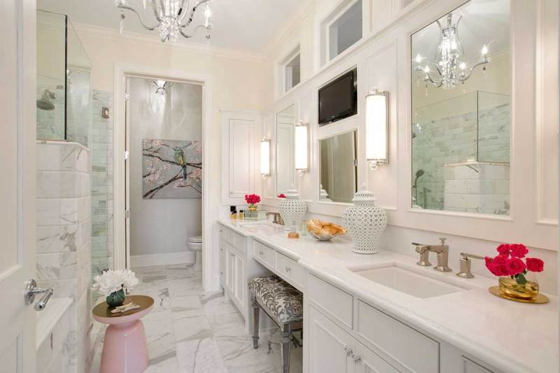white master bathroom with crystal candle chandelier and wall sconces