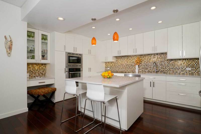 white kitchen with orange glass pendant light