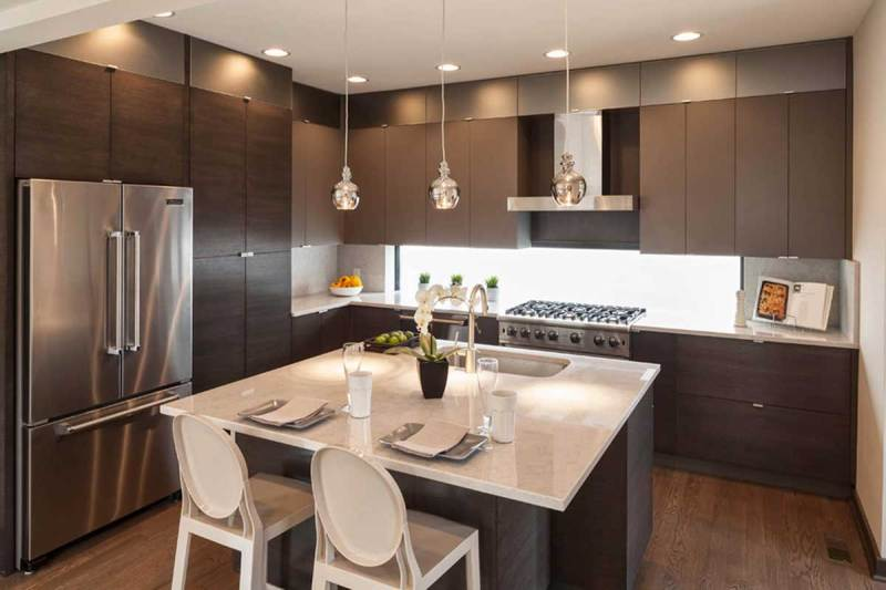small gray kitchen with chrome mini pendant lights