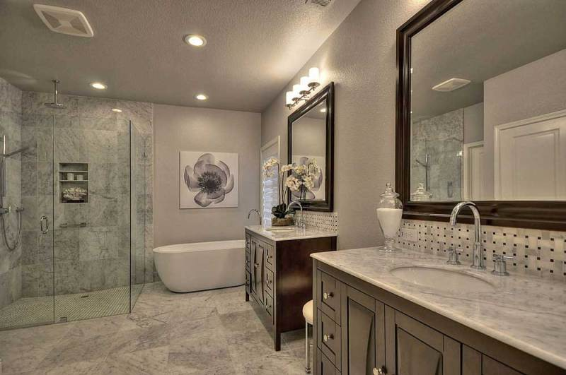 master bathroom with wall sconce light fixtures