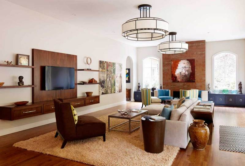 living room with modern drum pendant light