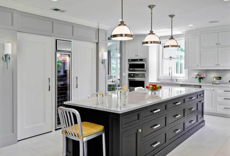 black white kitchen with satin nickel pendant lights